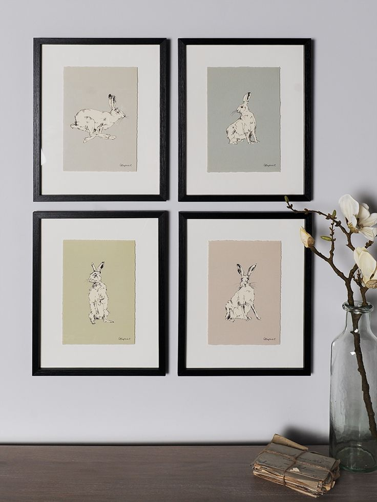 Presented in quality black composite frames, our hare prints have been beautifully illustrated using pen and ink on a coloured background with torn edges. With stunning illustrated details in four different styles, choose between running hare on a grey ground, facing hare on a taupe ground, turning hare on a soft blue ground and standing hare on a sage green ground. Can't decide which is your favourite? Display all four together in your living room or along your hallway to make an…