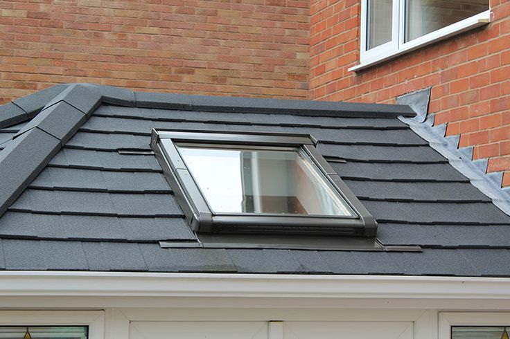 Tiled conservatory roof plus velux.