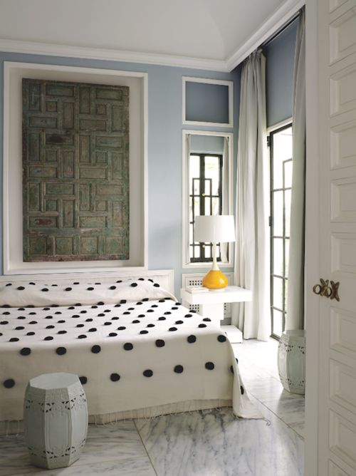 Home of Bruno Frisoni and Hervé Van der Straeten in Tangier, with playful pom pom coverlet.