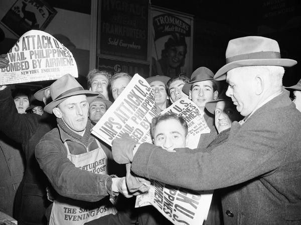 Selling papers on December 7, 1941 at Times Square in New York City, announcing that Japan has attacked U.S. bases in the Pacific.