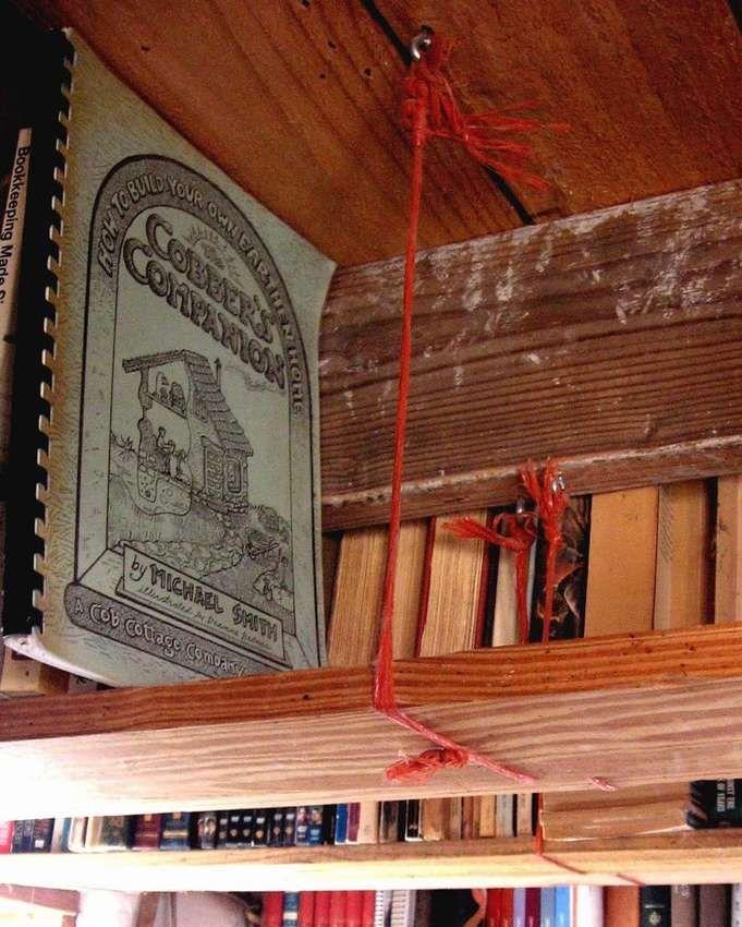 Mount shelves near the ceiling for books