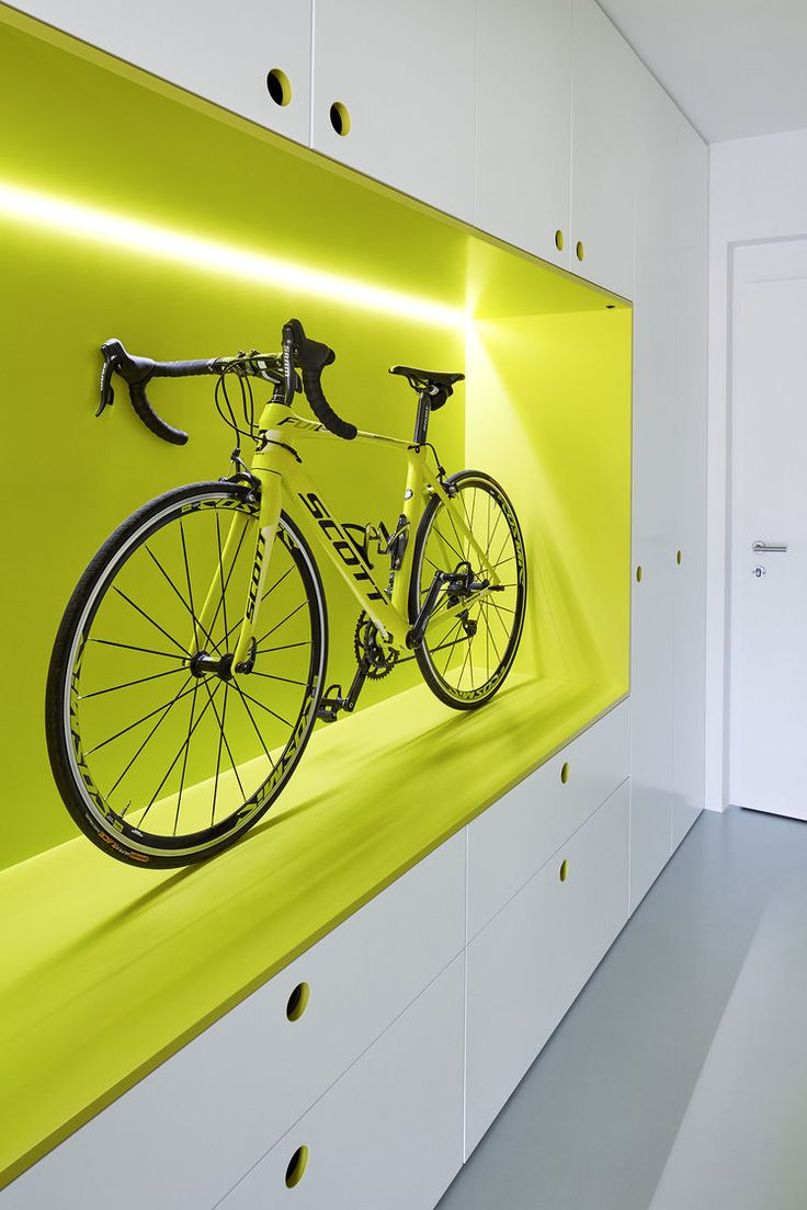 Bike storage and polyurethane floors in hallway of Prague guest apartment by…