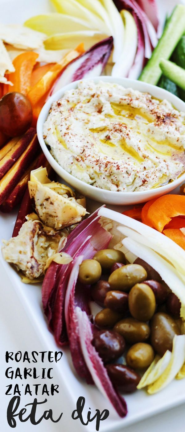 This savory Za'atar Roasted Garlic Feta Dip is the perfect summer appetizer and simply bursting with flavor. This post is sponsored by Cavit Wines to create recipes that pair with Pinot Grigio in celebration of National Pinot Grigio Day!