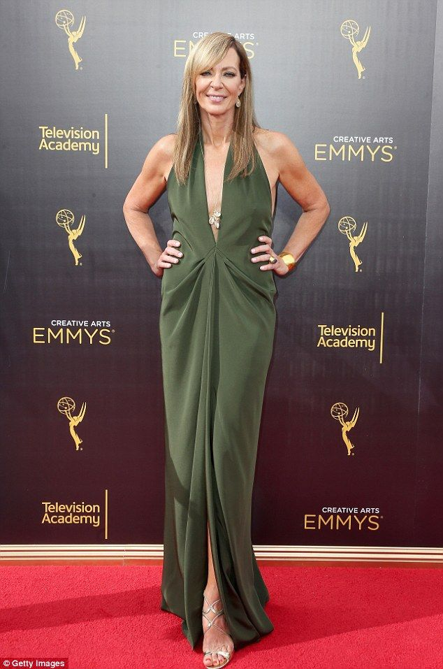 Gorgeous in green:Allison Janney hit the red carpet in a plunging olive green gown with a front slit to show off some leg and her gold strappy stilettos