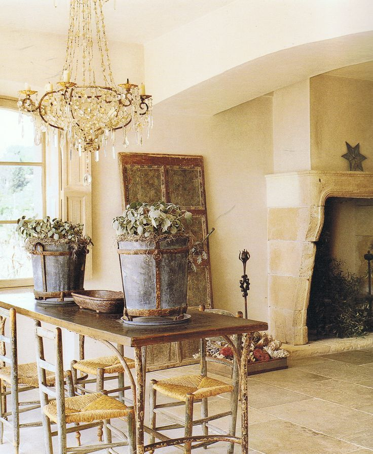 This Country French Dining Room Shows The Essential Elements Fireplace Mantel Limestone Floor Low Stuccoed Ceiling And Windows