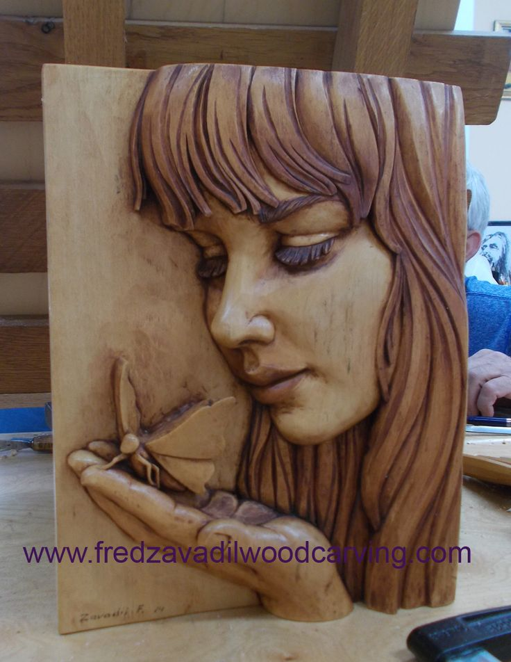 relief wood carving, fred zavadil basswood, girl with a butterfly