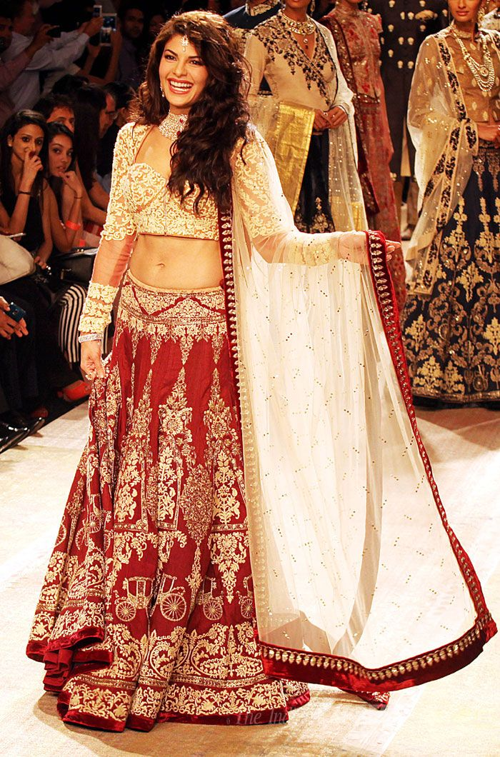 Jacqueline Fernandez looked absolutely stunning in a gorgeous red and gold bridal lehenga at the Lakme Fashion Week Winter/Festive 2014 Day 2. #Bollywood #Fashion #Style #Beauty