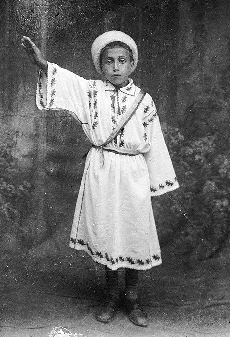 A young boy salutes in a photograph by Costica Acsinte  #romania #vintage #blackandwhite