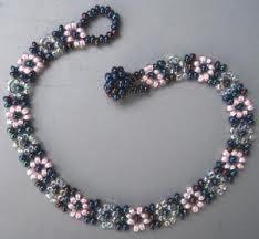 flower beaded bracelet tutorial video another easier one http://www.youtube.com/watch?v=ZuGAo9srakU