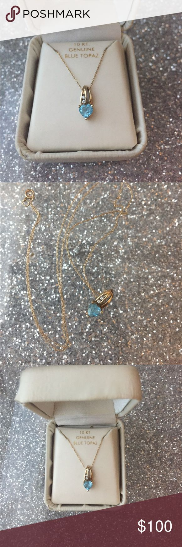 10kt Gold and Blue Topaz Necklace Delicate 10 my gold necklace with a genuine blue topaz and cubic zirconium detailing. The chair is incredibly delicate and stunning. Jewelry Necklaces