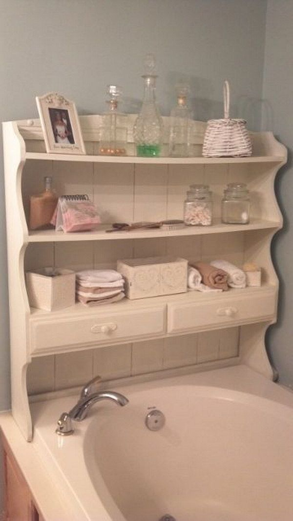 Top of An Old Hutch Painted and Upcycled Into Shelves For The Bath