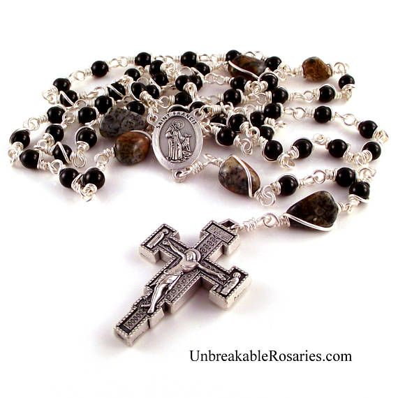 This is a traditional Dominican five-decade rosary. It will last a lifetime. All of my rosaries - should the construction break during normal prayer - may be returned at any time for free repairs. Beads: 6mm Shiny black onyx for the Aves and approx. 12mm golden brown amphibolite for the Pater beads.  Crucifix: 1.75 Franciscan renaissance crucifix with the Blessed Virgin Mary and St John the Evangelist on opposite ends of the crossbar. Beautiful detail. Measures over 1/4 thick. Made in It...