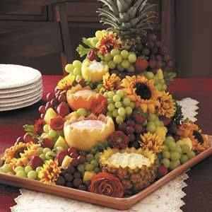 Beautiful fruit display. Use succulents instead of sunflowers