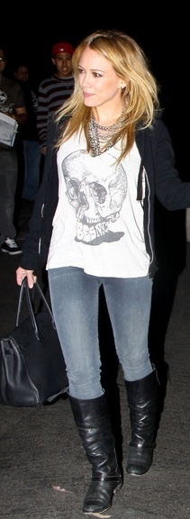 Who made Hillary Duff's black boots, black purse and skull shirt that she wore in Hollywood on July 12, 2010?