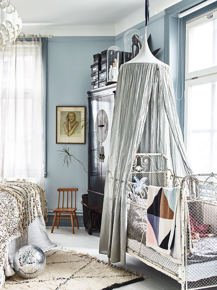 This is such an elegant room. I love the blue walls & high ceilings. Take some design inspo from the baby crib & bedroom decor!