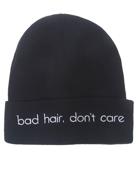 "Don't worry about bed head with this super cute knit beanie featuring the words ""bad hair, don't care"" embroidered on the front of the adjustable cuff. Beanie has a stylishly snug fit.  100% Acrylic 	Imported"