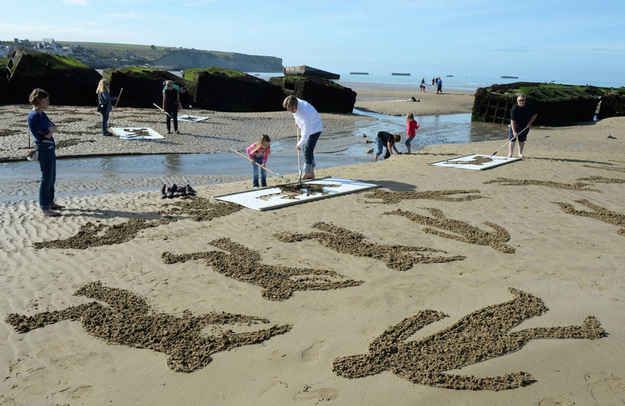 On World Peace Day , artists Jamie Wardley and Andy Moss recruited a team of volunteers to create an installation on the beach, by way of tr...