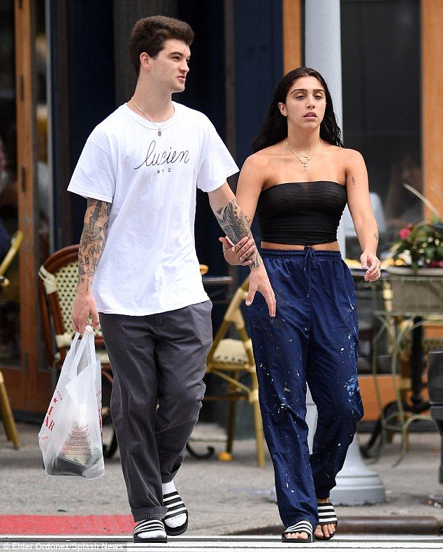 Her man: The 20-year-old, who appears to have dropped out of college, was spotted locked in an embrace with a young tattooed man in the Upper East Side