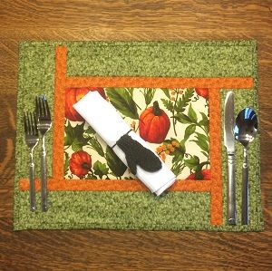 Merry Mitten as a napkin ring for a Thanksgiving table setting.