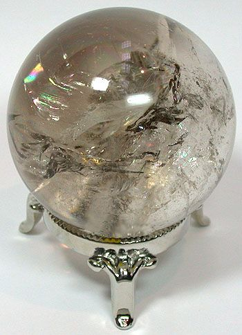 Smokey Quartz Sphere~grounding and stabilizing, relieves stress, fear, jealousy, anger and other negative emotions by transforming them into positive energies; brings prosperity, good luck, and protection pixiecrystals.com