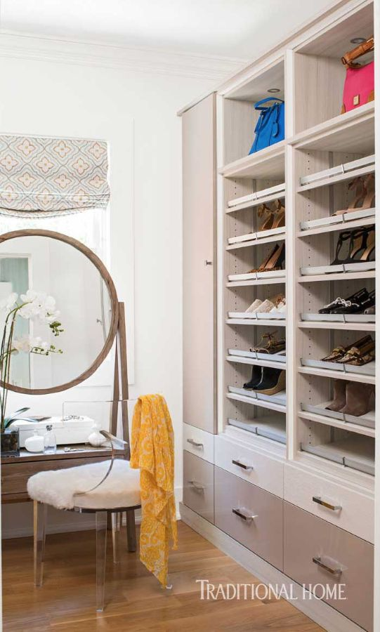 The Spacious Dressing Room For Her With Vanity And Round Mirror Features A  Custom Closet System By California Closets.