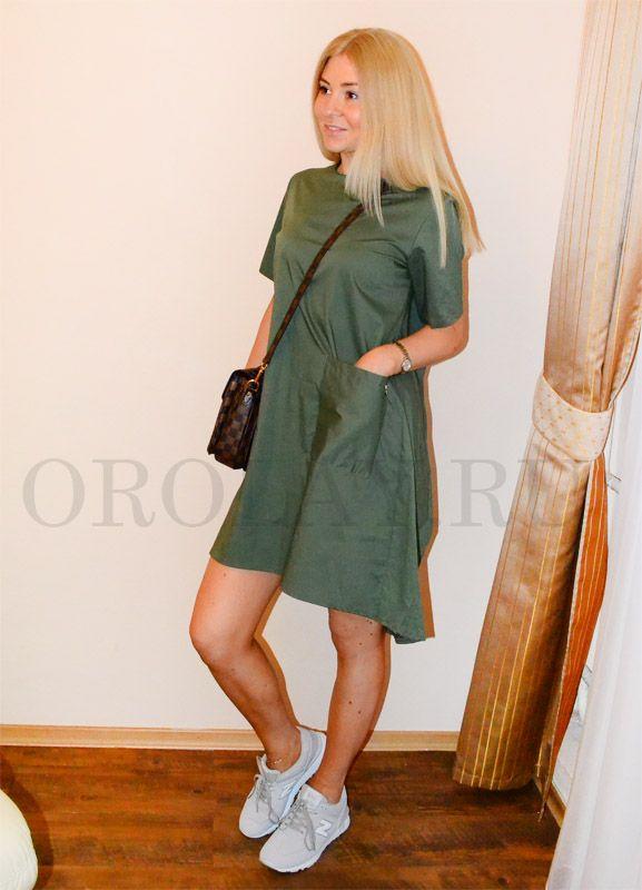 Купить модное женское платье цвета хаки недорого. Отличное платье из 100% качественного хлопка.Сзади удлиненный подол.Воротник лодочкой. Одинаково уместно будет смотреться и на выход и на работу и на встречу. Размер универсальный 42-46. Производство Италия.