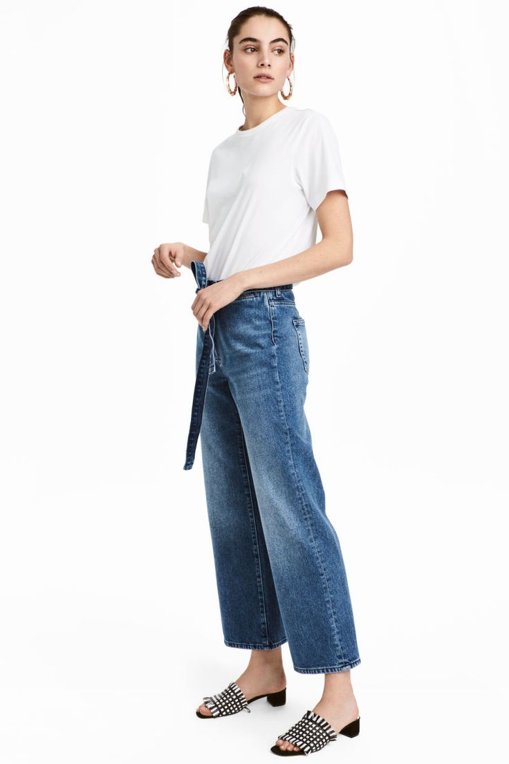 Denim blue. Wide-leg jeans in washed denim with a high waist, concealed