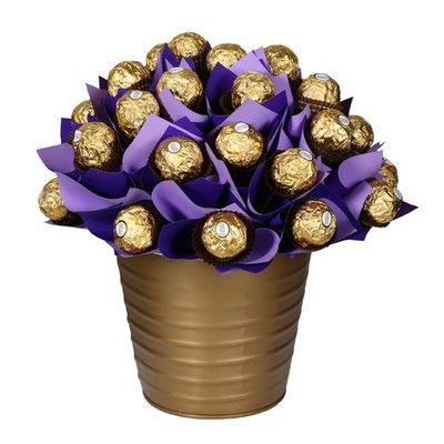 A feast for Ferrero fiends! This uber-indulgent bouquet boasts 30 of everyone`s favourites chocolates, Ferrero Rochers. Presesnted in regal purple and gold shades, it`s a gift fit for a king! Includes: 30 Ferrero Rocher chocolates, Keepsake purple bucket, Complimentary gift wrapping and gift card.