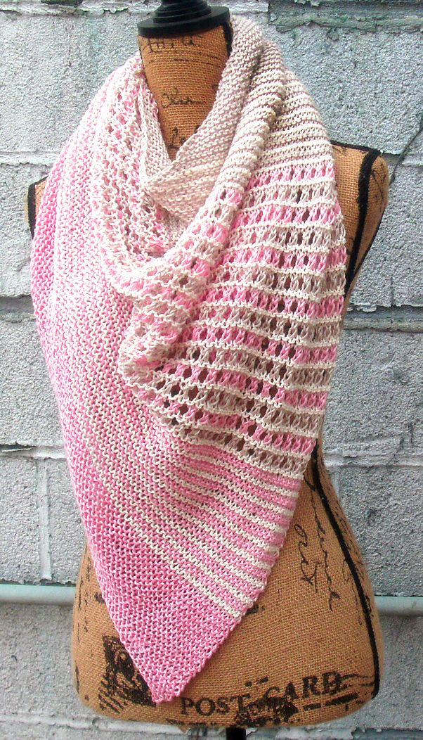 Free Knitting Pattern for Pirate Cove Shawl - Garter stitch stripes alternate with striped eyelet section in this triangle shaped shawl. DK weight yarn. Designed by Hilary Latimer