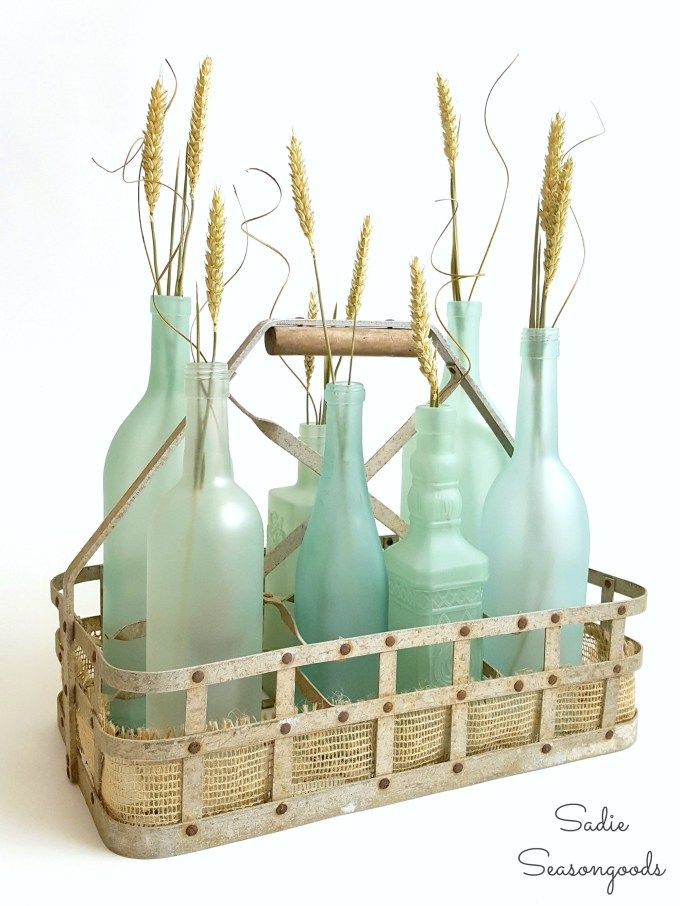 Creating DIY Coastal Beach Decor with sea glass spray paint and frost etch effect paint on glass wine and liquor bottles by Sadie Seasongoods /www.sadieseasongoods.com