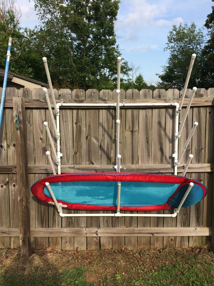 DIY PVC pool side storage for pool floats and toys.