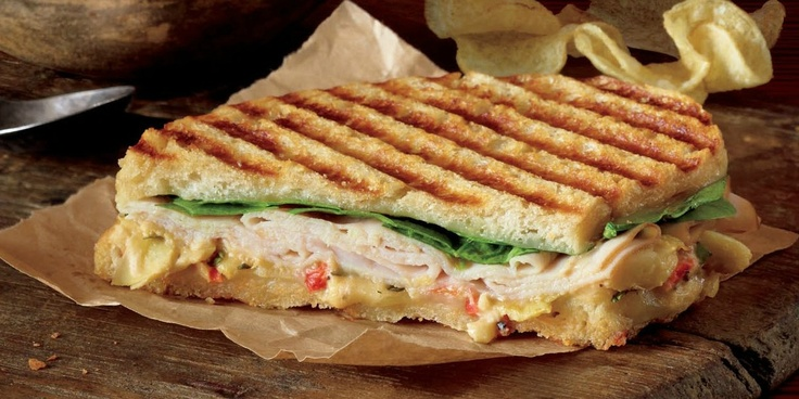 Corner Bakery's new Monterey Panini - smoked turkey, fresh spinach, Asiago artichoke spread on grilled sourdough. Yum.