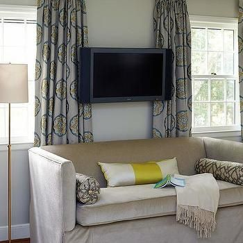 Flat Panel TV Over Taupe Bedroom Sofa