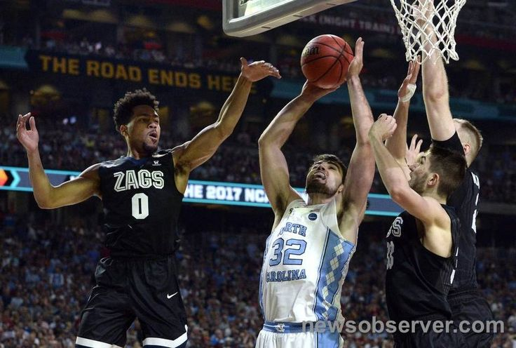 UNC forward Luke Maye (32) gets a first half shot blocked by Gonzaga defenders Monday, April 3, 2017 at the NCAA Final Four National Championship game in Glendale, Az. at the University of Phoenix Stadium.