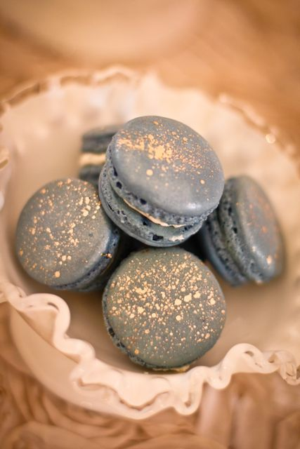 New Year's Macarons! Blue macarons with gold dust Can't say I have ever had one, but they look pretty :0)