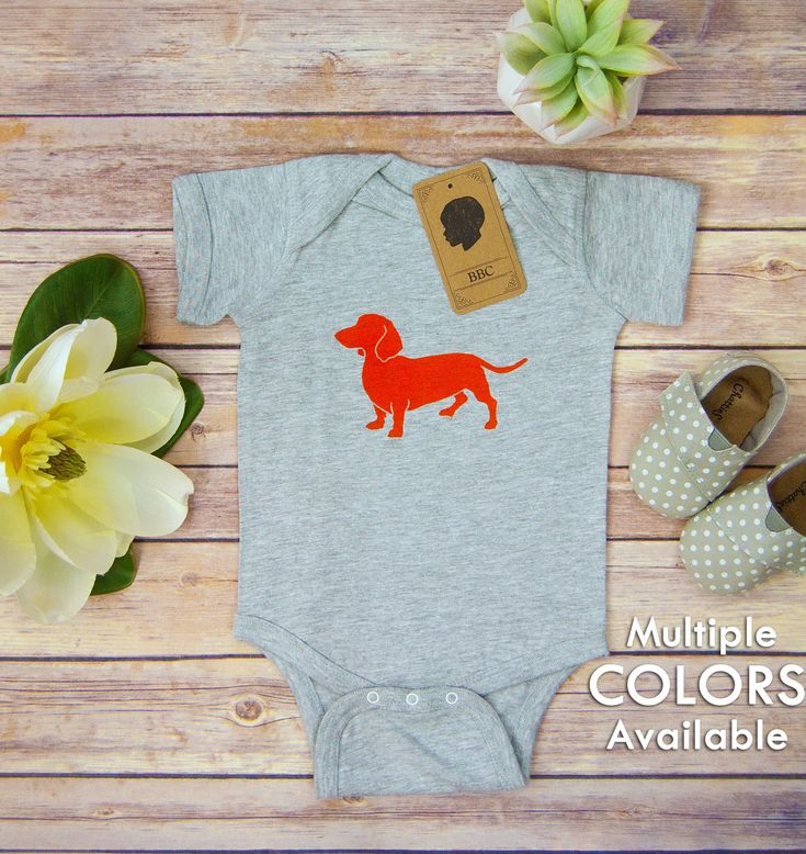 Adorable linoleum block printed baby bodysuit with dachshund design! An awesome gift for a birthday or baby shower! #dachshund #doxie #doxiebaby #babyboy #babygirl #baby #babyclothes #infant #infantclothes #wienerdog