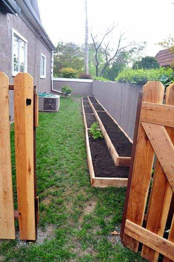 build long and narrow garden beds along the side yard fence