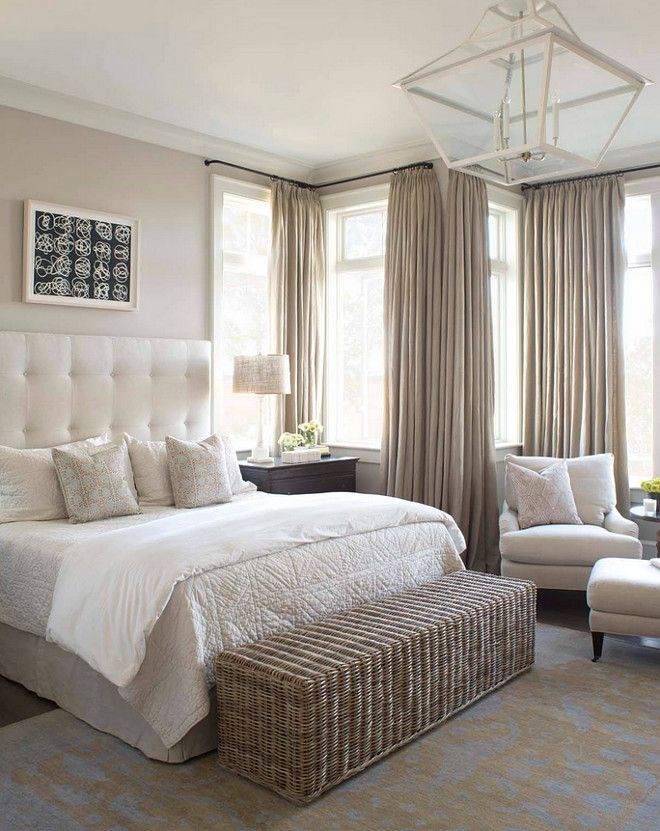 neutral master bedroom with linen draperies silk rug