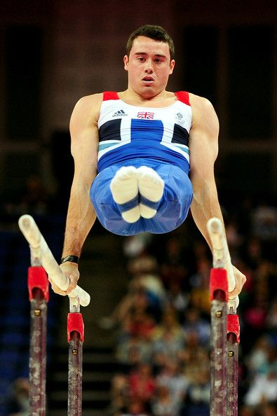 Kristian Thomas of Great Britain performs on the Artistic Gymnastics Men's Parallel Bars on day one of the London 2012 Olympic Games at North Greenwich Arena on July 28, 2012 in London, England.