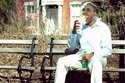 President Obama's ratings tank after a picture is taken of him eating a footlong sandwich on a bench alone.