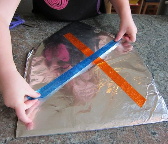 make shield - fun thing to do for the boys at Camy's party - party favor
