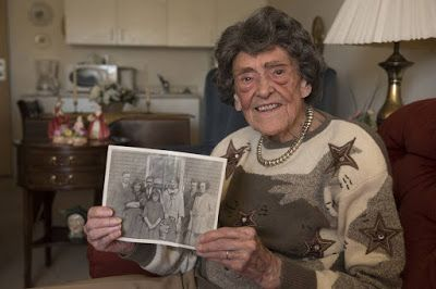 Kaye Chapman, 104, holds a photo of her parents and siblings taken a few years after the Halifax explosion of 1917. She now lives in Saint John. The Globe & Mail
