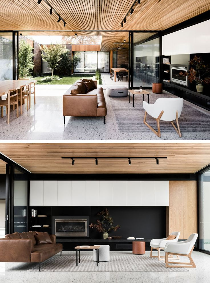 Inside this modern house, a timber batten ceiling contrasts the white concrete floor, keeping the interiors light and and airy. A black wall in the living helps to define the space in the large open room.