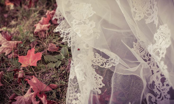 Bride's dress with fall leaves & a ladybug | Stunning vintage wedding photography by www.newvintagemedia.ca