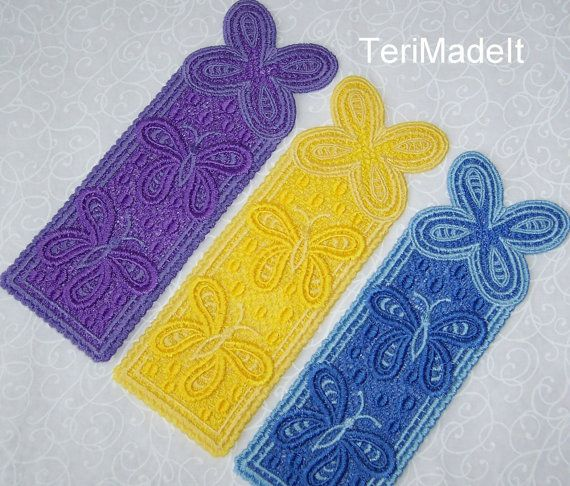 """This free standing lace butterfly bookmark or journal marker is a perfect gift for the nature lover or gardener. Beautiful embroidered freestanding lace butterflies flutter across this light and airy design. Each bookmark is made with two shades of the same color, giving a dimensional texture to the design. Dimensions: 6 ⅜"""" high x 2 ⅛"""" wide They make inexpensive, yet thoughtful and unique gifts for just about any occasion. ~ Give them to your book lover friends ~ Include one with a thinking…"""