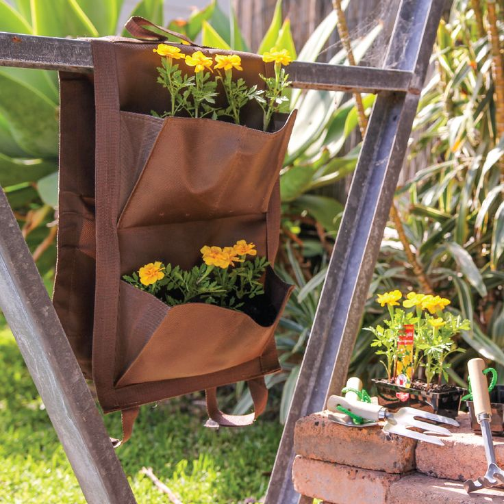 Plant herbs and small flowers in this adorable vertical garden planter