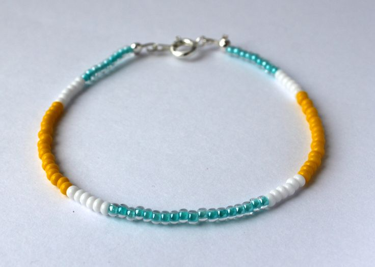 Seed Bead Bracelet-Bracelet with Meaning-Wire-Protection-Purity-Happiness-Turquoise-White-Yellow by celineandluna on Etsy https://www.etsy.com/listing/278574690/seed-bead-bracelet-bracelet-with-meaning
