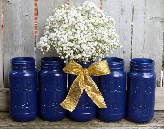 Navy Blue and Gold Wedding / Mason Jar by CarolesWeddingWhimsy, This set of 5 Navy Blue Mason Jars with Gold Ribbon are the perfect wedding centerpiece or centerpiece for any occasion.  You can find them here https://www.etsy.com/listing/253649617/navy-blue-and-gold-wedding-mason-jar