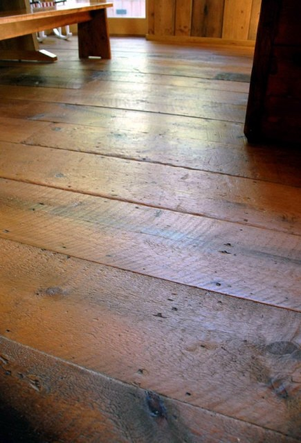 Original refinished pine plank floors throughout the house Salvaged pine flooring