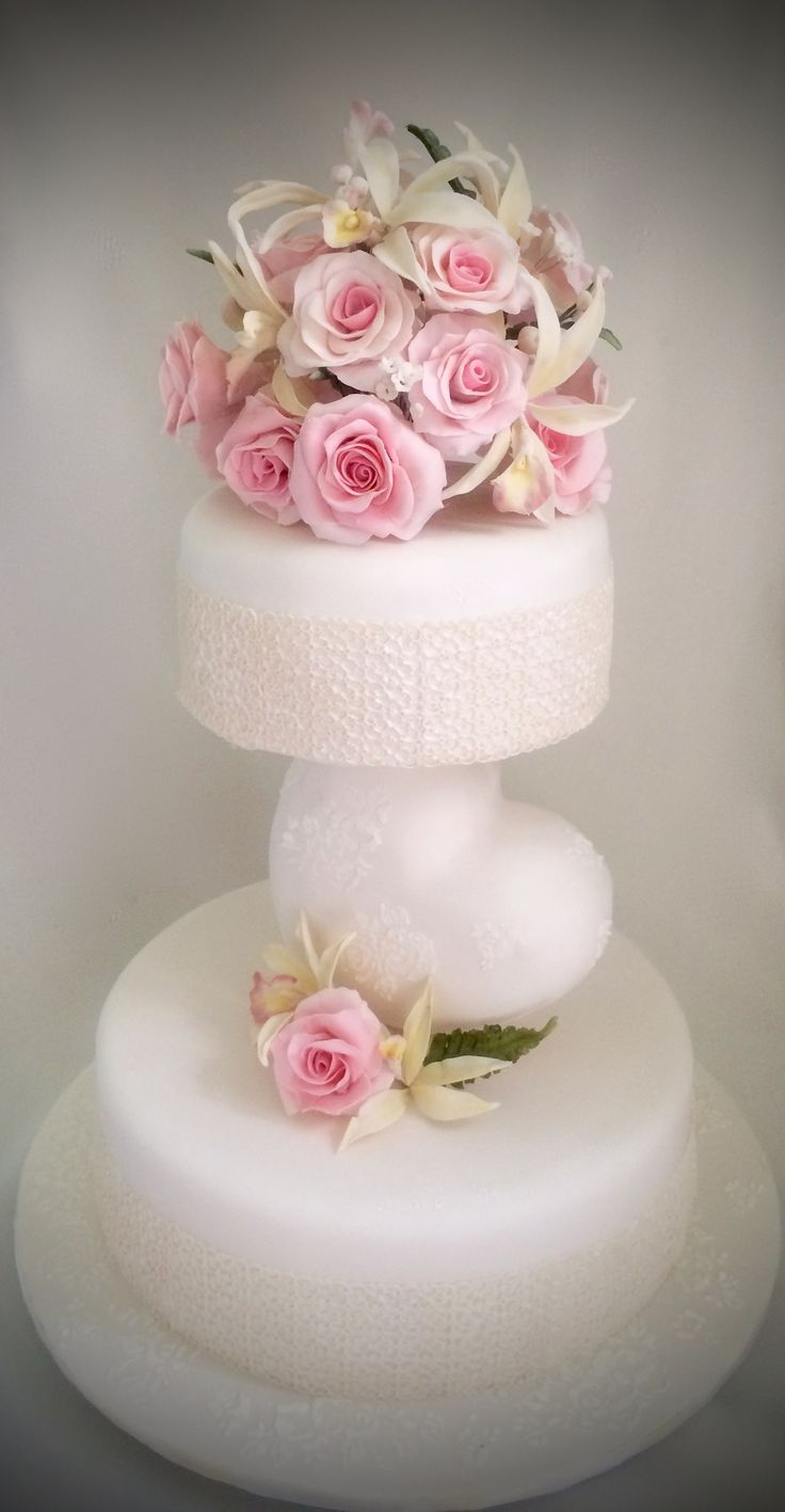 Cake show entry  Wedding cake  with roses , orchids and baby's breaths